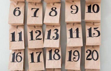 calendarios-de-adviento-hecho-con-rama-y-bolsas-kraft-con-cilps-y-cuerdas