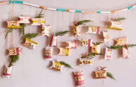 calendarios-de-adviento-hecho-con-ramas,-rollos-de-papel-higienico,-cinta-washi-tape-y-ramitas-de-abeto-con-pinzas-ropa