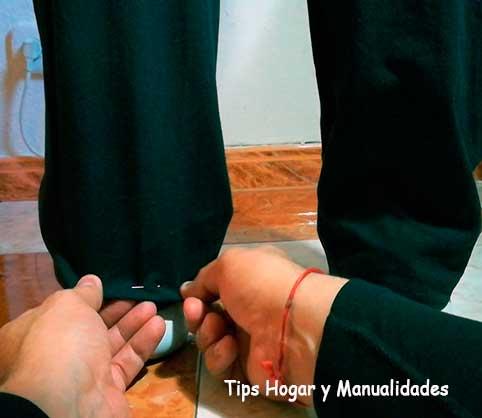 Subir los bajos de un pantalón