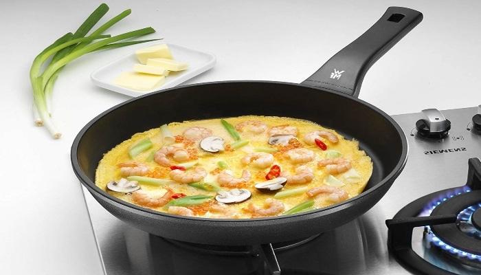 cocinando paella en wmf permadur